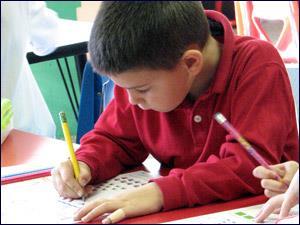 Boy filling in test